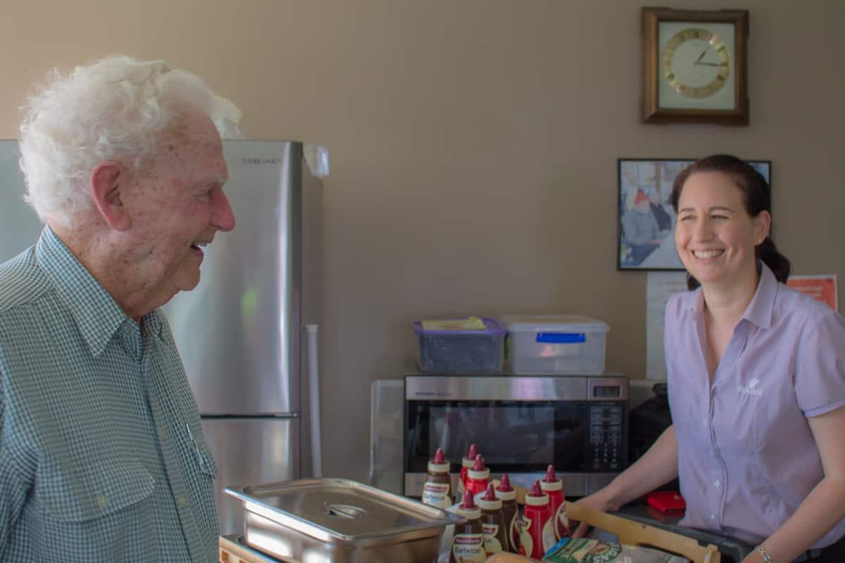 Resident and staff chatting at Yukana BBQ