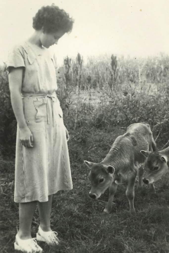 Alison with poddy calves while visiting Len's family farm in Kalbar