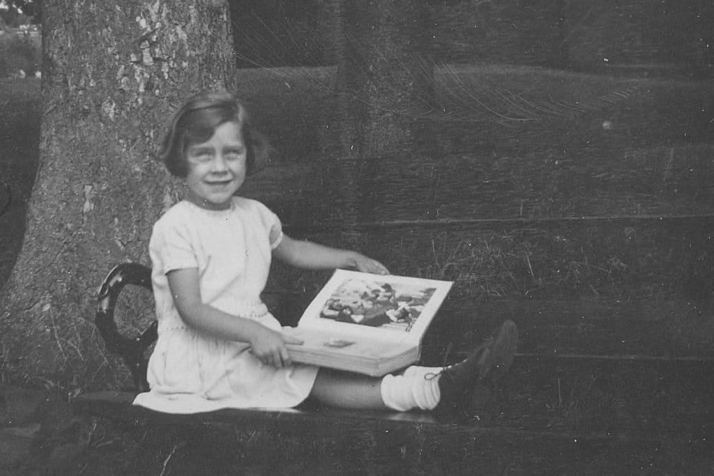 Girl reading in Bristol Park, England